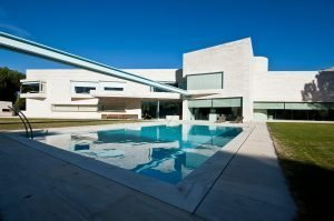 Spectacular swimming pool with contemporary villa in the background in Pozuelo Madrid