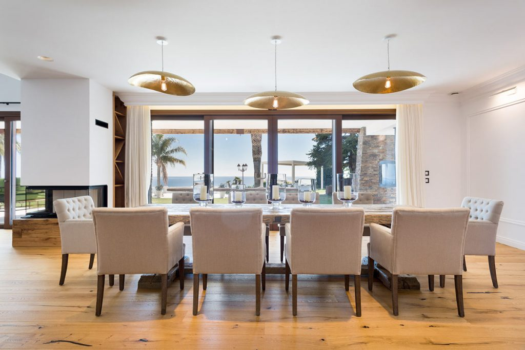 Supreme elegance meets panache - elegant dining room with views over the Mediterranean sea from villa in Sant Andreu de Llavaneres