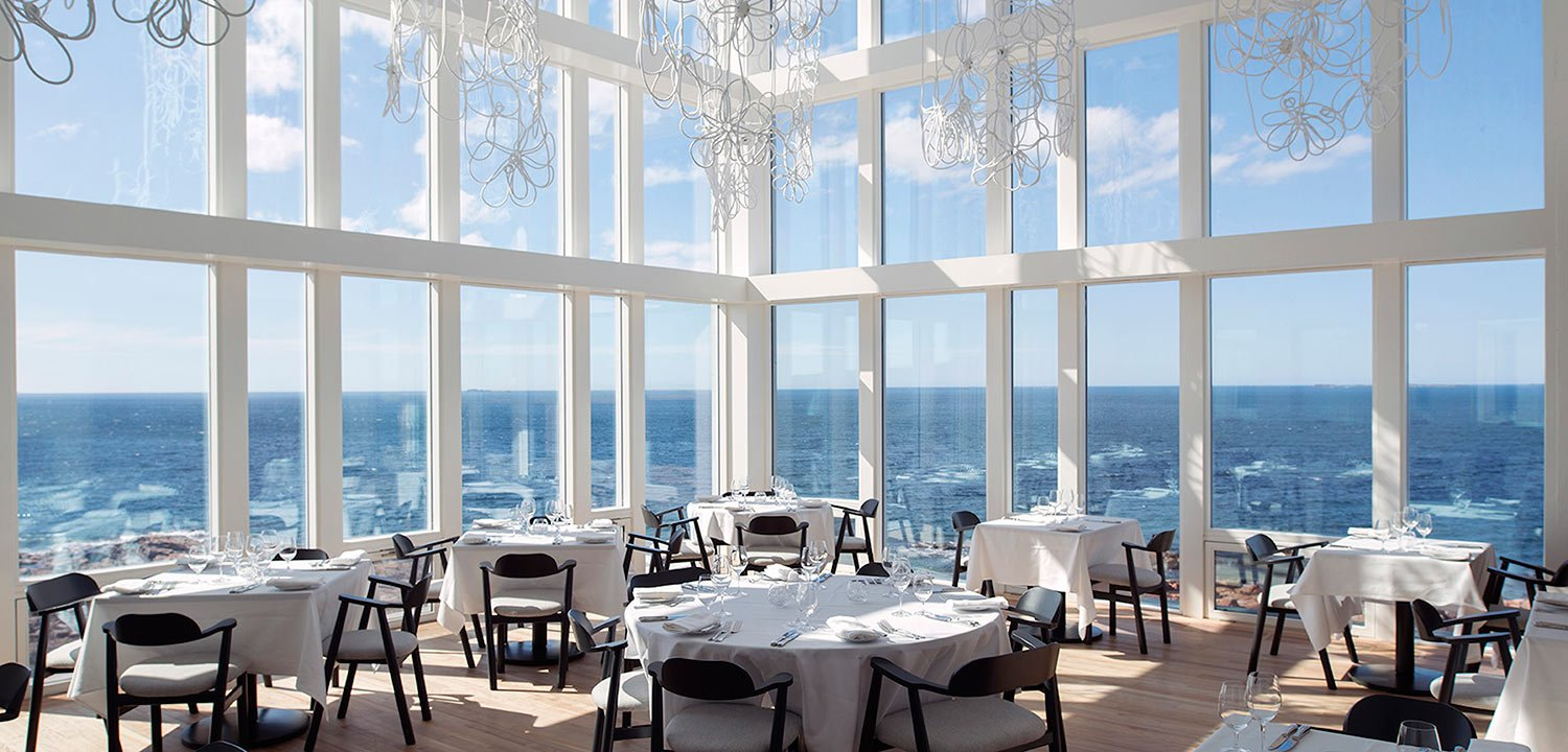 Dining room with large windows facing the ocean