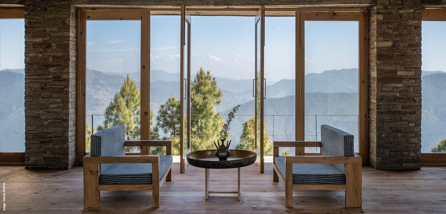The lounge at The Kumaon retreat overlooking the himalayas
