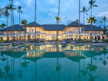 The Sanchaya hotel in Bintan Indonesia resembles an imposing colonial mansion house with colonnade-fronted buildings, white plantation shutters and courtyard