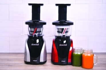 Tribest slow juicer in two different colours, silver and red