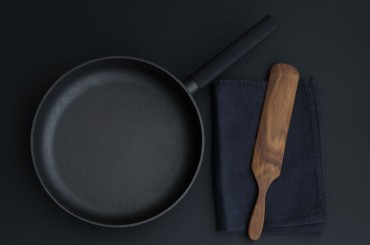 Skeppshult cast iron pan agains black background