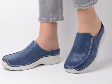 Woman wearing blue comfortable shoes