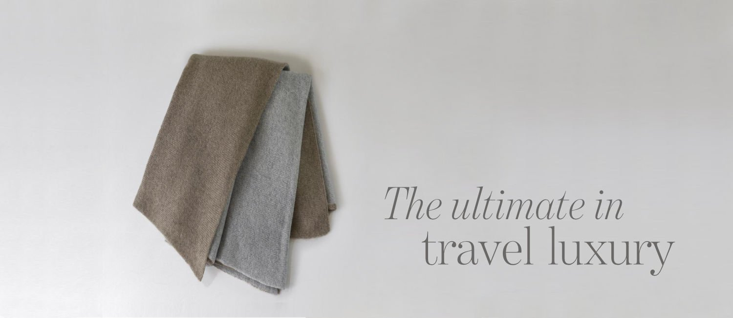 Cashmere travel shawl with the text 'The ultimate in travel luxury'
