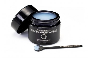 Truth Treatment Systems Transdermal C Balm with the lid open to show the structure of the balm