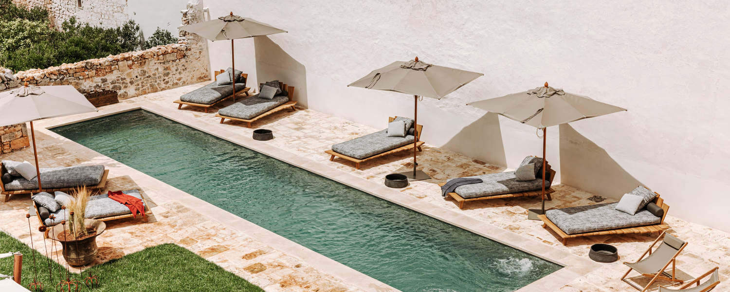 Hotel pool with sundeck and sun loungers