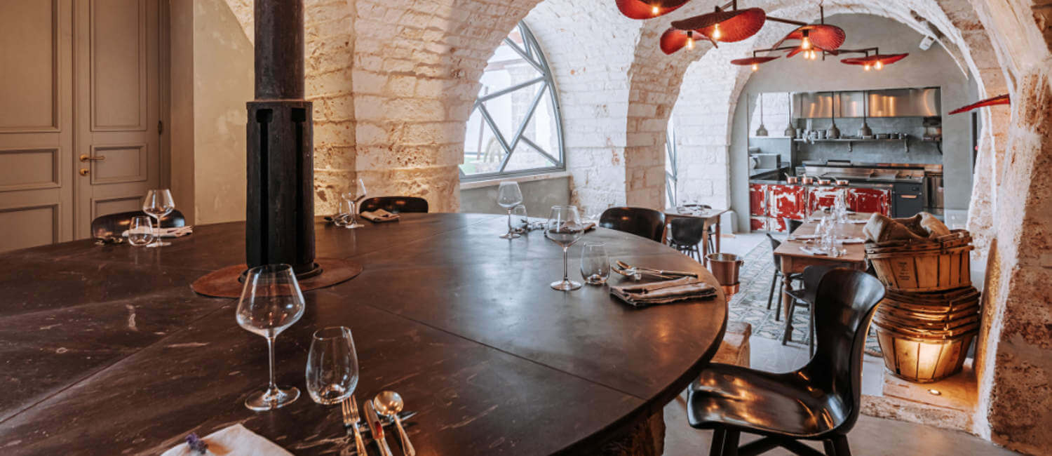 Old olive press converted to dining table in hotel restaurant